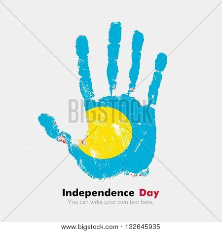 Hand print, which bears the Flag of Palau. Independence Day. Grunge style. Grungy hand print with the flag. Hand print and five fingers. Used as an icon, card, greeting, printed materials.