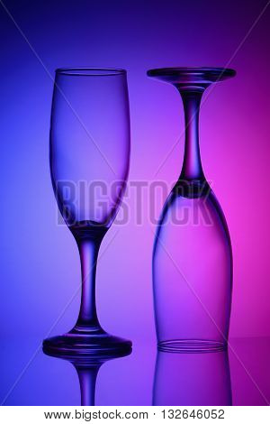 Two empty glasses in the bicolor light