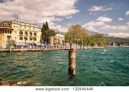 Riva del Garda Italy - April 15 2016: The town of Riva del Garda seen from the lake.