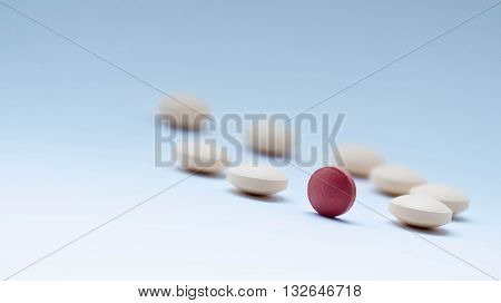 tablets, yellow and one orange, orange symbolizes the sun, everything turns around pharmacology, blue background similar to the sky, pharmacology decline,