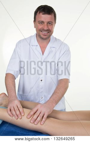 Man Massaging Girl Calf Muscle, Therapist Applying Pressure On Leg.