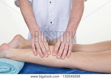 Therapist Massaging Human Calf Muscle.therapist Applying Pressure On Female Leg.