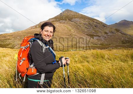 Smiling Hiker Posing At The Foot Of Carrauntoohil