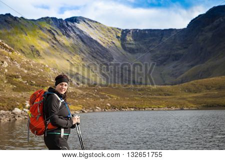 Female Hiker Posing At A Lake In The Mountains