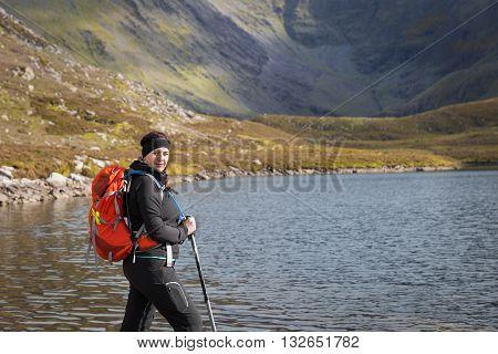 Female Trekker Posing Lake Side In The Mountains
