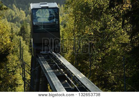 funicular railway over the autumn forest horizontal