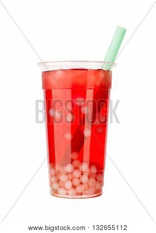 Red bubble tea with white tapioca and green straw, isolated on white