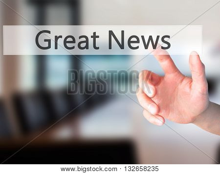Great News - Hand Pressing A Button On Blurred Background Concept On Visual Screen.