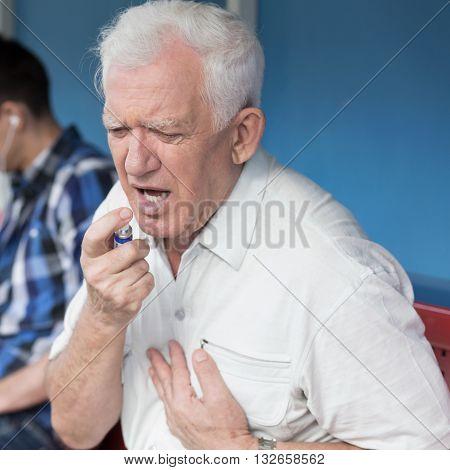 Senior Male Having Heart Attack