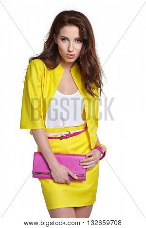 Fashion young model in yellow style against white wall