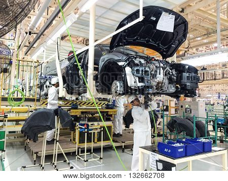 PRACHINBURI Thailand - May 12 2016: Employees of Honda Automobile Thailand work at the assembly line on a Honda car at Prachinburi plant in Rojana Industrial Park.