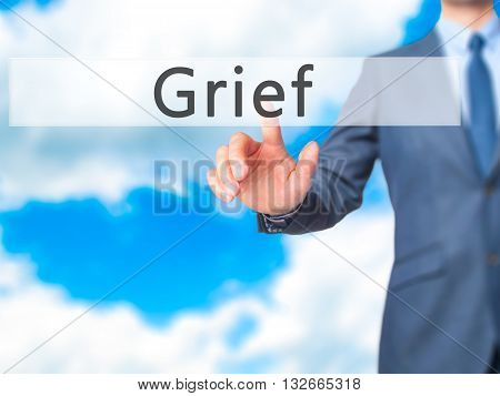 Grief - Businessman Hand Pressing Button On Touch Screen Interface.