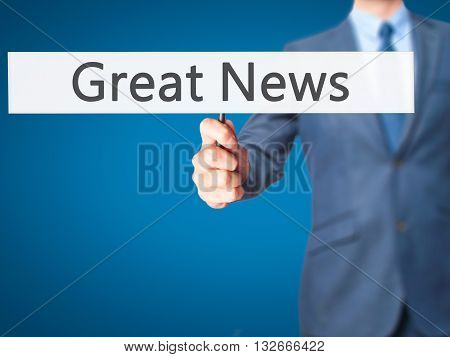 Great News - Businessman Hand Holding Sign