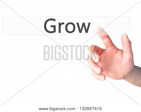 Grow - Hand Pressing A Button On Blurred Background Concept On Visual Screen.
