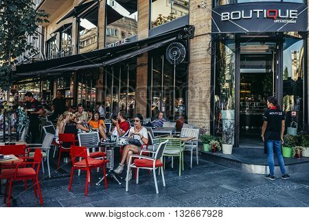 Belgrade Serbia - August 29 2015. People sits in Boutique restaurant located on the Square of the Republic