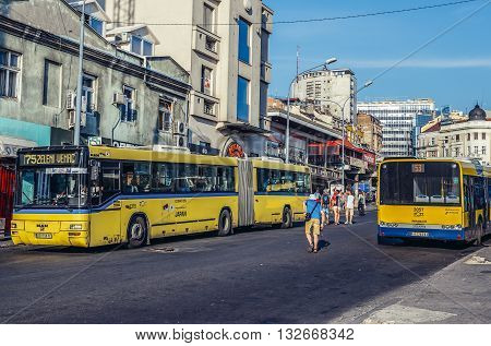 Belgrade Serbia - August 29 2015. Yellow buses on the street Bus in Zeleni Venac district