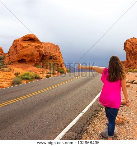 Woman at the road in Valley of Fire State Park in Nevada USA