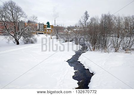 SERGIYEV POSAD RUSSIA - January 02.2010: River Konchury with very cold water which is shifted even in cold weather. Sergiyev Posad