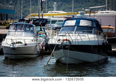 Two White yacht on dock in sea
