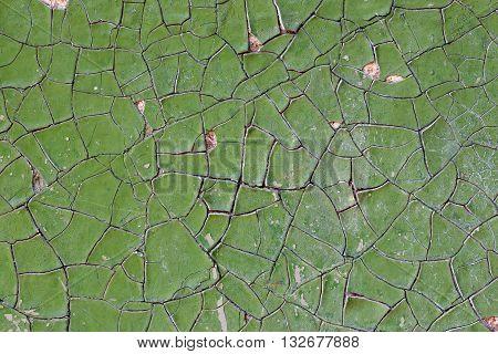 deep cracks broken the paintwork green color