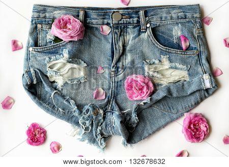 short ripped denim shorts with roses flat lay