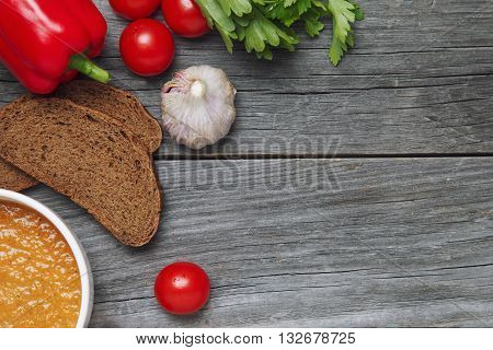 Cup With Fresh Gazpacho, Herbs And Croutons. Viewed From Above. On Wooden. Empty Space For Text