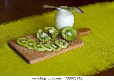 Healthy nutritious snack or breakfast on wood and green background