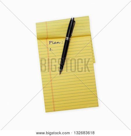 Pen laying on an opened note pad isolated on white background