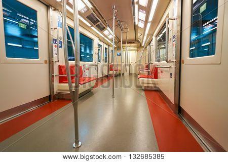 DUBAI, UAE - MARCH 09, 2016: interior of the train at Dubai International Airport. Dubai International Airport is the primary airport serving Dubai, United Arab Emirates