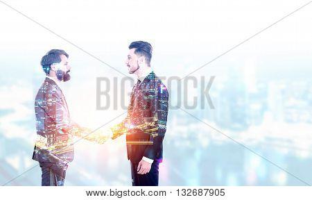 Two bearded businessmen shaking hands on illuminated night city background. Double exposure