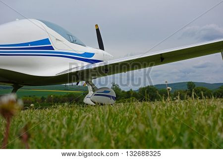 small sport aircraft at the airport , green grass