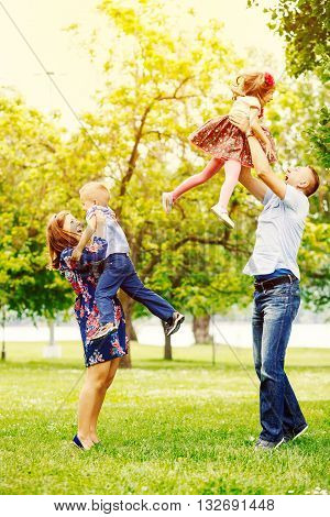 Playful happy family in the park enjoy together