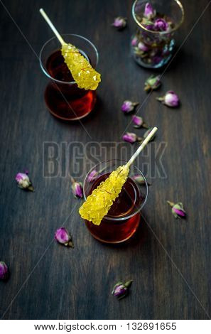 Nabat - a crystalized sugar candy and tea with dried rose flower. Iranian tea culture and cuisine. Middle Eastern food photography.