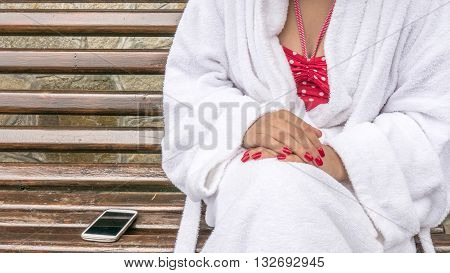 Sitting Woman With White Mobile Phone