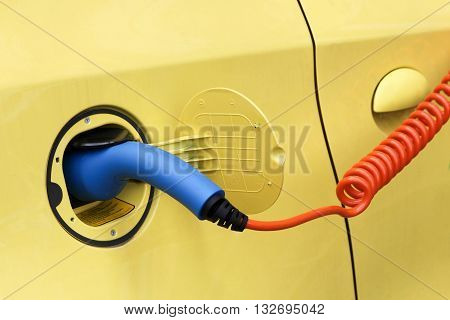 Electric car in charging station, green and renewable energy technology