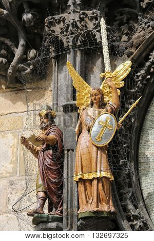 Statues of Angel and Philosopher at Prague astronomical clock