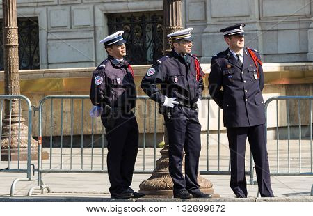 Paris France-May 08; 2016 : The unidentified police officers on Champs Elysees avenue in Paris during commemoration of Victory day in World War II.