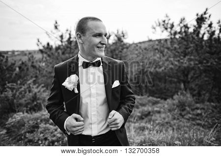 Close Up Portrait Of Mega Stylish Groom Man With Bow Tie, B&w Photo