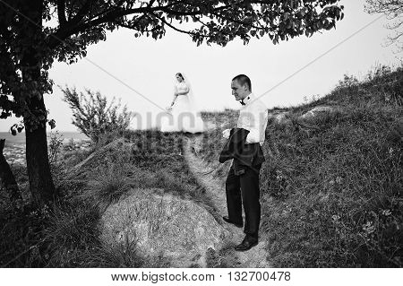 Stylish Groom Man Holding The Jacket On Hand Background Bride, B&w Photo