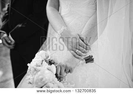 Hand With Bouquet Of Groom And Bride At Church, B&w Photo