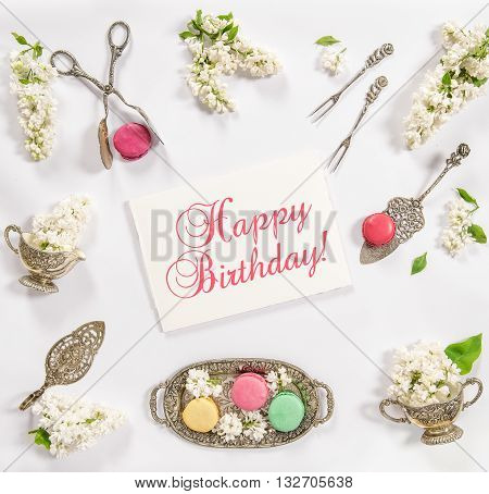 Macaroon french cookies vintage dishes. Happy Birthday card concept