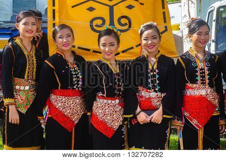Penampang,Sabah-May 30,2016:Kadazandusun girls of Sabah Borneo in traditional costume during Pesta Kaamatan.Pesta Kaamatan or Harvest Festival is a major yearly event for the Kadazandusun in Sabah,Borneo.