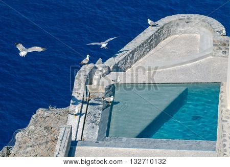 Swimming pool on the slopes of the volcano in the village Fira. Greece. Santorini.