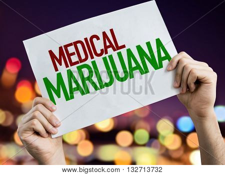Medical Marijuana placard with night lights on background