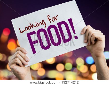 Looking for Food placard with night lights on background
