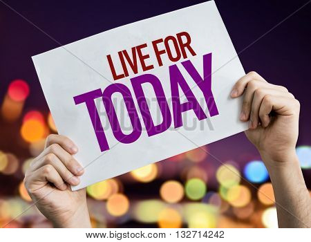 Live for Today placard with night lights on background