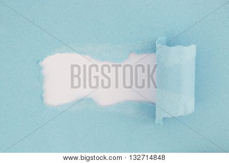High resolution photography of torn blue paper - visible paper texture