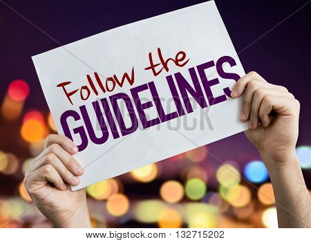 Follow the Guidelines placard with night lights on background