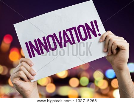 Innovation placard with night lights on background