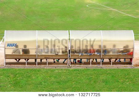 Soccer Players And Staff Sit On Bench Beside The Soccer Field (away Team)